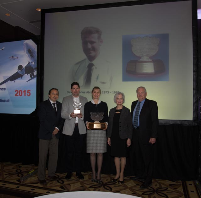 L to R – Wayne Gouveia, VP General & Commercial Aviation, ATAC ; Clayton Reid, Heli-Pilot, Chinook Helicopters, ( husband of C. Press,  holding  her Keeper-Trophy,) Catherine Press Recipient,  Jane & Rikki Abramson Co-founders. Photo  courtesy of Mike Doiron.