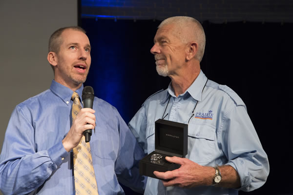 L to R. Director Michael Fox presenting Rick Willms, CFI, Prairie School of Mission, with aviator's watch from Hamilton